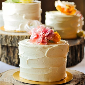 Katie and Dan couldn't decide on just one flavor, so they chose to have multiple smaller cakes! Various shades of roses topped each confection.