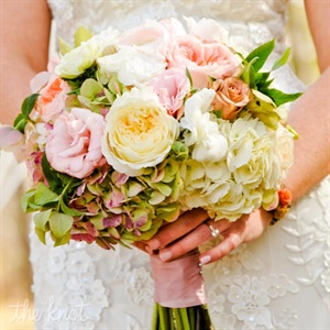 Jessica&#39;s bridal bouquet inspired much of the day&#39;s design. She carried a romantic gathering of roses, hydrangeas and greens.