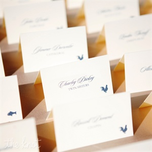 Simple tented escort cards were decorated with elegant navy script font.