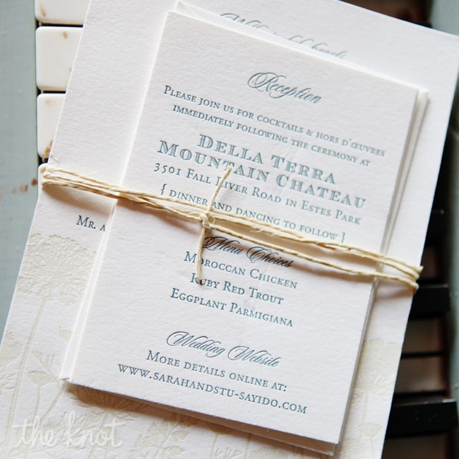 The couple's letterpressed wedding suite was tied together with raffia for an elegant yet rustic look.