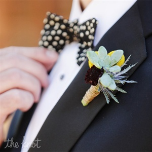 Stuart wore a succulent and billy ball boutonnniere on his lapel. The whimsical bout was the perfect complement to his black and white polka dot bow tie.