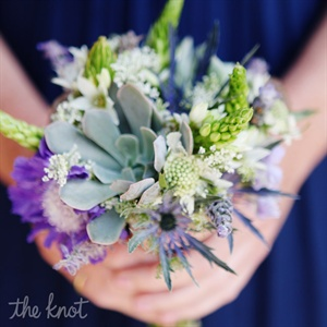 The bridesmaids carried petite bouquets of succulents, blue thistle and various greens.
