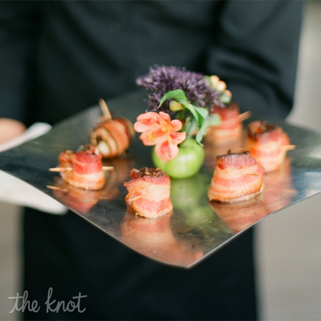 Among other delicious appetizers, guests noshed on applewood smoked bacon wrapped scallops.