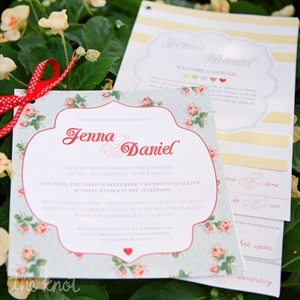 Jenna designed the couple's sweet floral wedding invitations and tied them with red and white polka dot ribbon.