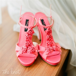 For a pop of color to her day-of look, Jenna wore these pink-coral heels with fabric rosettes on them.
