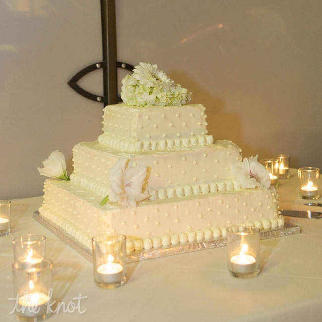 The bride and groom wanted something simple for the wedding cake so they chose a three-tiered vanilla cake with vanilla buttercream frosting.