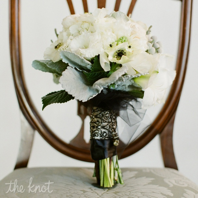 White blooms accented with silver leaves and berries were ties with black-and-white ribbons.
