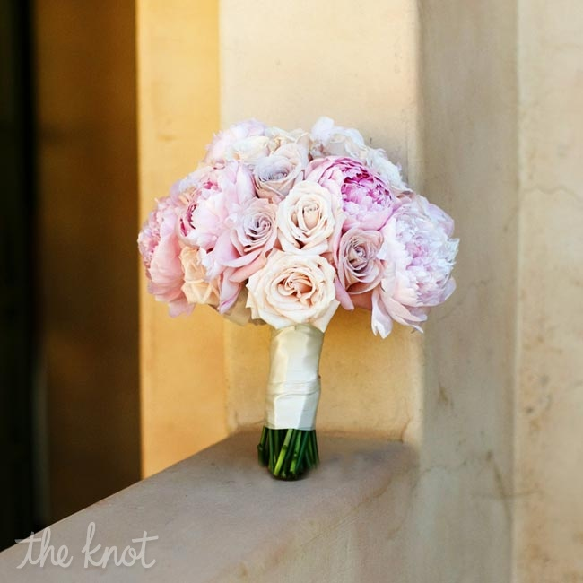 Caitlin incorporated her favorite flowers- eskimo roses, peonies and garden roses- with her wedding colors to create her soft and romantic bridal bouquet.