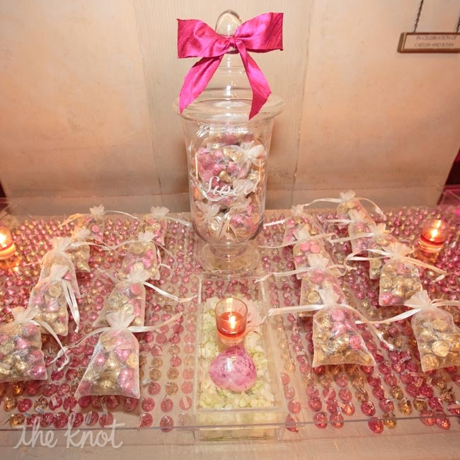 The bride's mom collected Hershey kisses for months leading up to the wedding to help create this amazing table which also served as the escort card table at the beginning of the night.