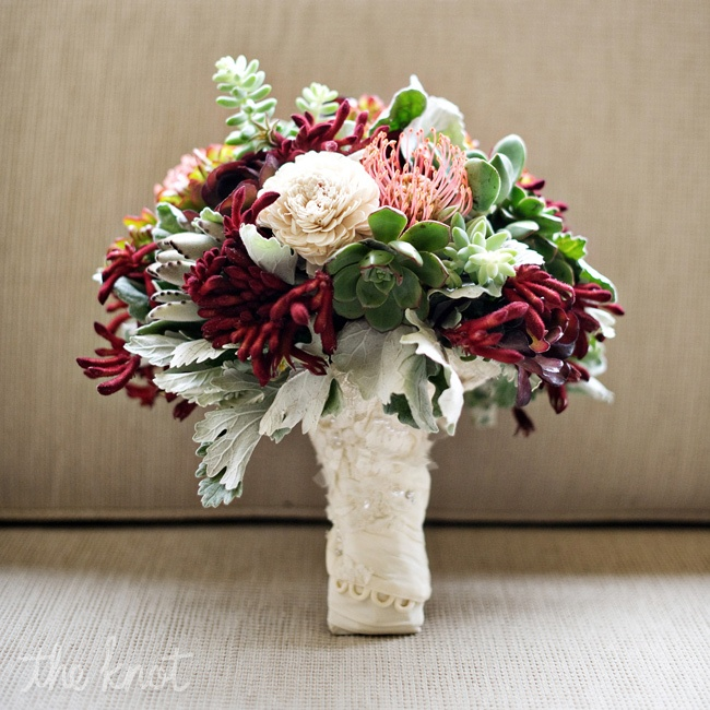 A full bouquet of the succulents, dusty miller, pincushion proteas and kangaroo paws.