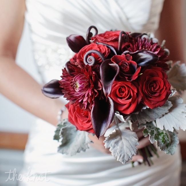 Heather carried a bold bunch of deep red roses, calla lilies, fiddlehead ferns and dusty miller.