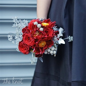 The bridesmaids carried red roses and silver brunia in their bouquets.