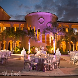 Tons of candles bathed the lilac-and-ivory-clad tables in soft, intimate light.