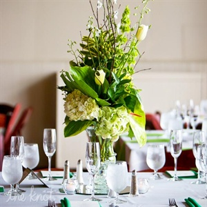 Tall vases were filled with hydrangeas, orchids and various greenery for a lush, exotic look.