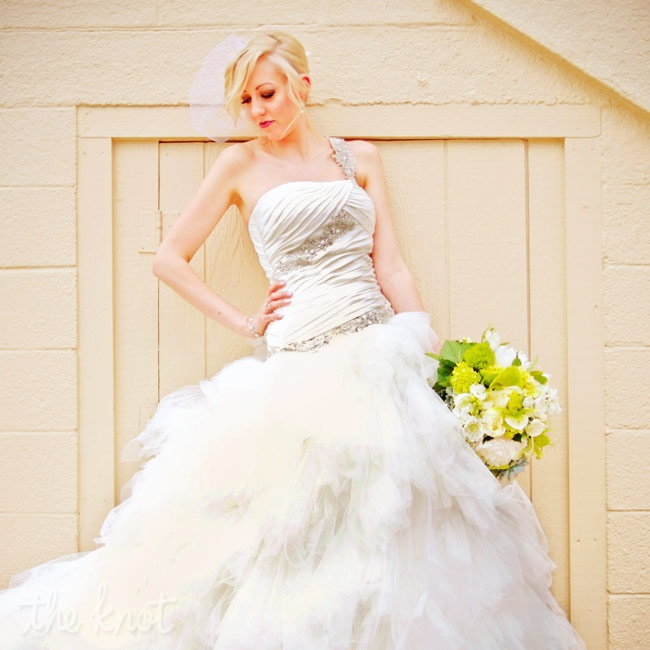 "Corie says, ""I wanted to look like a fairy princess, and the dress was perfect!"" She chose a dropped waist gown with a ruched bodice and an airy tulle skirt."