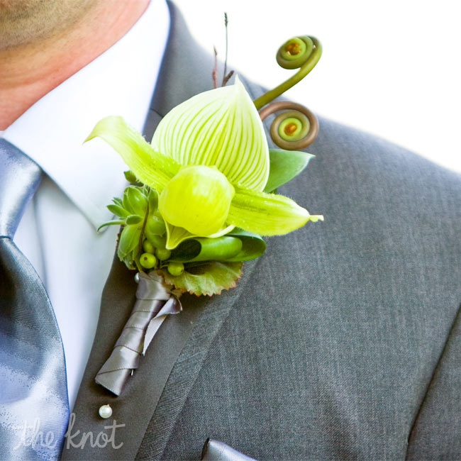 Adrian wore a green lady slipper orchid on his lapel accented with berries and a fiddlehead fern.