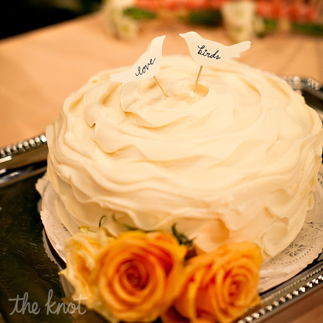 Renita and Alex's cake was chocolate cake with chocolate buttercream inside and white buttercream frosting outside was made by Magnolia Bakery. The love bird cake toppers added a dash of whimsy to the petite cake.