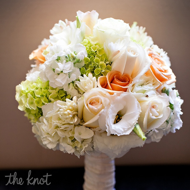 Renita's bouquet was soft and feminine in cream and peach tones with hints of lime green. It featured a mix of hydrangeas and roses.