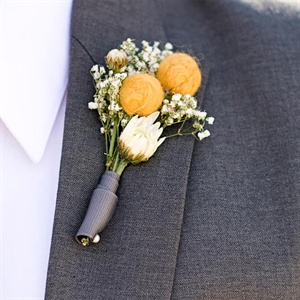 Alina made faux billy balls and added fresh white ranunculus for fun boutonnieres.