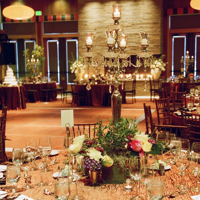 The candle centerpieces were surrounded with fresh flowers to create a warm ambience.
