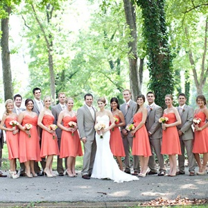 The girls all wore the same coral strapless dress. The groomsmen chose matching dark tan suits.