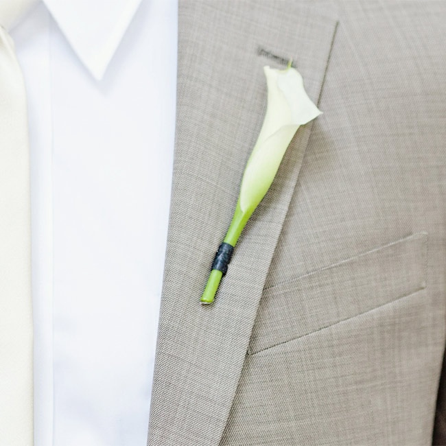 Chase wore a single white calla lily boutonniere to match Michelle's bouquet.