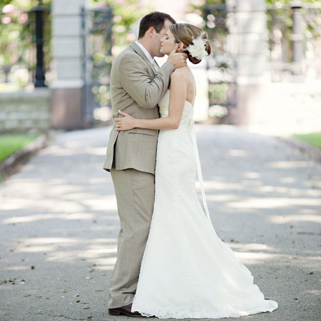 Michelle wore a fit and flare ivory gown with a sweetheart neckline. Chase wore a dark tan suit like his groomsmen.