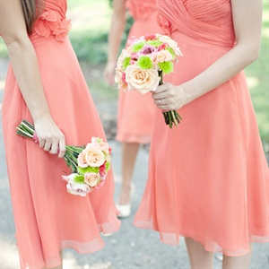 The bridesmaids carried small bunches of pink garden roses, peach roses, purple godetia and green button mums.