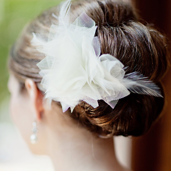 Michelle wore a tulle flower with feather accents in her elegant updo.