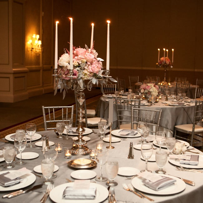 Silver candelabras were topped with light pink and white roses, ranunculus, astilbe and hydrangeas. Elegant silver linens added a formal touch.