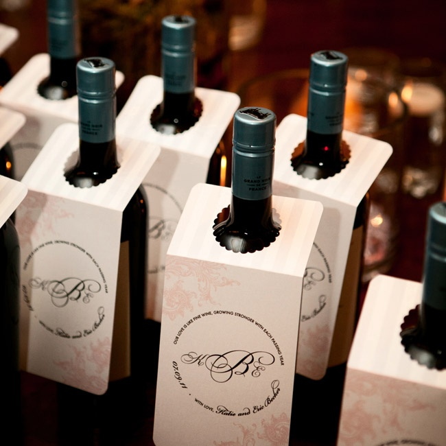 Each single guest or couple took home their own bottle of wine. The couple made tags that they draped over the bottles for a personal touch.