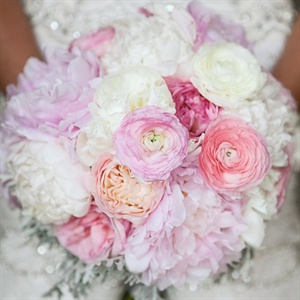 Katie carreid a light pink and white peony, ranunculus and cabbage rose bouquet. The florist added eucalyptus seed she painted silver to pick up the beadwork of Katie's dress.