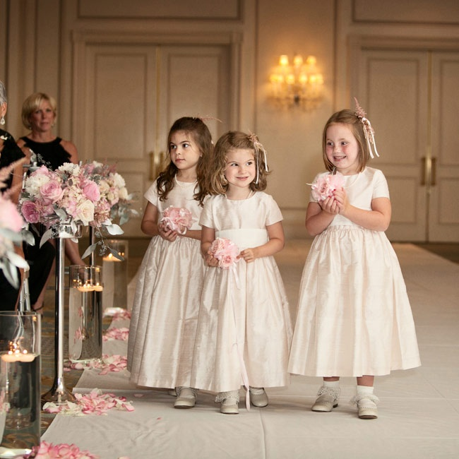 The three flower girls wore adorable pale pink dresses and carried small tea rose pomanders down the aisle.