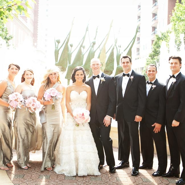 Katie wore an elegant strapless beaded gown with a sweetheart neckline. The guys all wore handsome black tuxedos, while the bridesmaids chose floor-length platinum silk dupioni dresses.