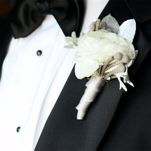 The guys wore a white rose with silver brunia and lamb's ear.