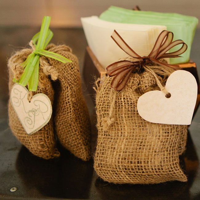 These were chosen because Kim's dad grows pistachios and sells them to Nichols Pistachios for processing, packaging and distribution. The burlap bags went with the theme & color palette, while the ribbon and the hearts/initials added a little color.