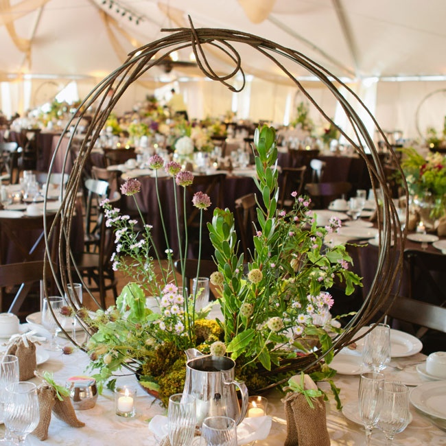The wreath-like centerpieces gave minimal, visual obstructions but still added a different volume & texture. All of the tables gave a look that this design could be seen in nature: the colors, the textures, and the even the bird feathers.