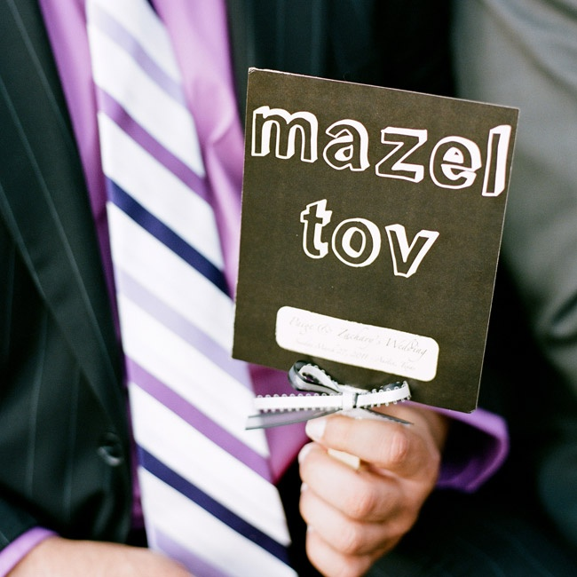 "The programs worked double time with important ceremony information on one side and ""Mazel Tov"" on the other side, meant to be held up once Zach broke the glass during the ceremony."