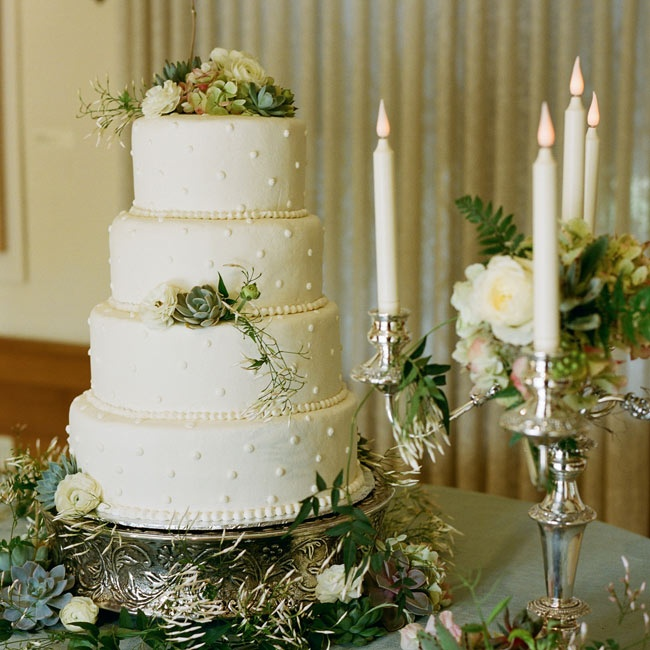 The three-tiered white cake was decorated with pearling, flowers and succulents.
