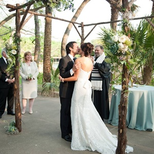 The wooden huppah was decorated with peonies, succulents and greenery for a natural look.