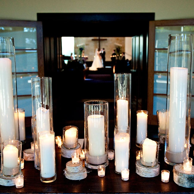 At the ceremony entrance, candles rested atop birch slabs for a wintry decor element.