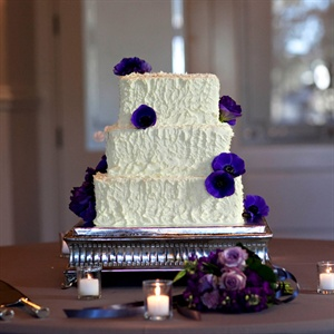 The couple served a white lemon buttercream cake that was topped with fresh purple anemones.