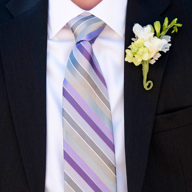 The guys wore purple striped ties; white boutonnieres served as the perfect complement.