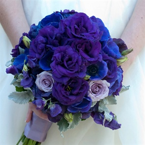 Danielle carried a bold bouquet of different colored purple roses.