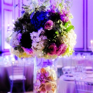 Fluted glass vases were topped with lush arrangements and filled with seashells as a nod to Abby's east coast roots.