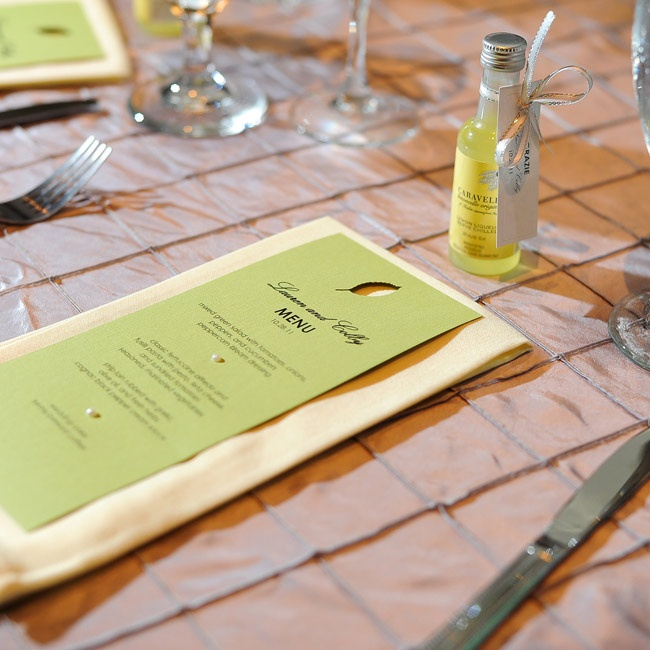 Mini bottles of imported Italian limoncello rested at each guests' seat along with green wedding menus.