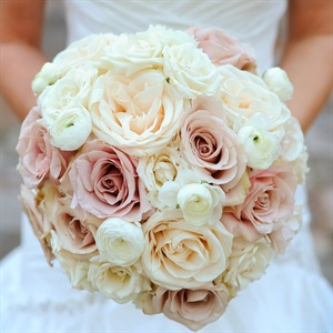 Lauren carried a romantic bunch of white and pale pink roses and ranunculus.