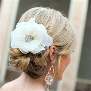 Lauren wore her something borrowed in her hair -- a friend of hers lended her the fabric flower pin. She paired elegant chandelier earrings for a touch of glam.