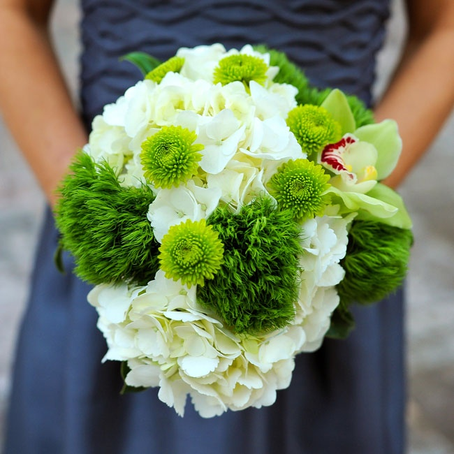 The bridesmaids carried lush bunches of white hydrangeas, green kermit mums, orchids and moss.