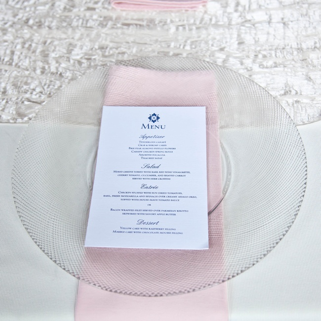 Guests sat down to blush napkins, textured glass chargers and simple navy and white menu cards that Heidi designed.